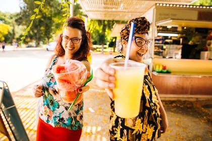 Tour guests with frozen drinks from a cart in Barcelona