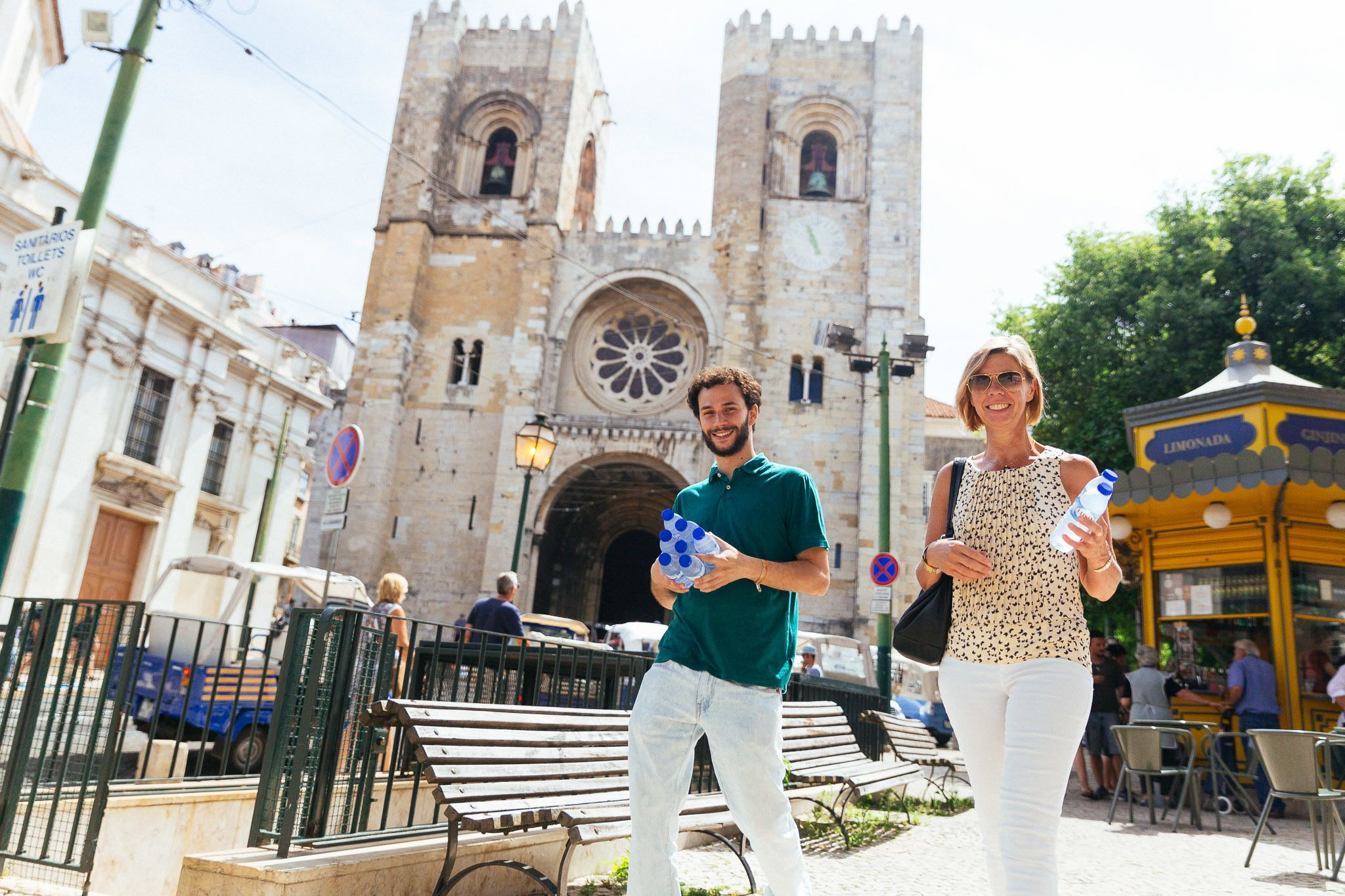 Couple walks in front of Lisbon Cathedral