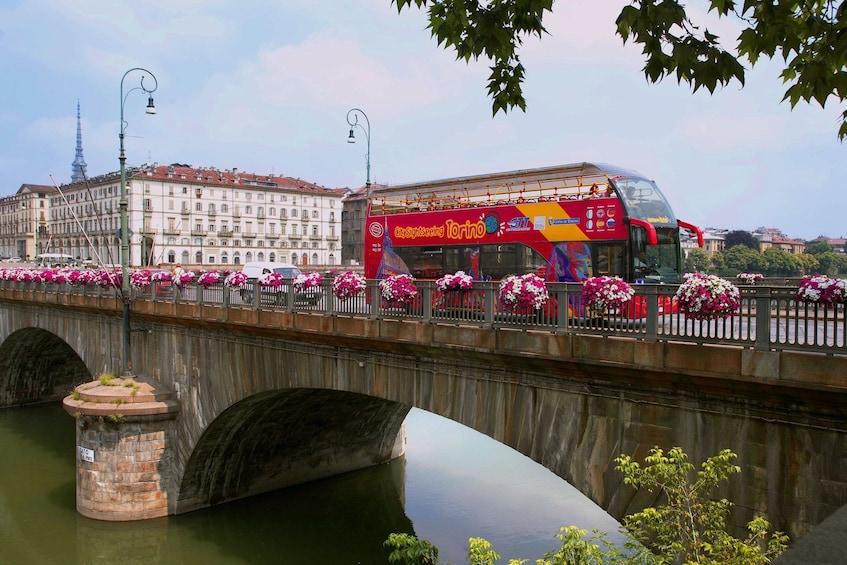 Hop-on hop-off bus on a bridge in Torino
