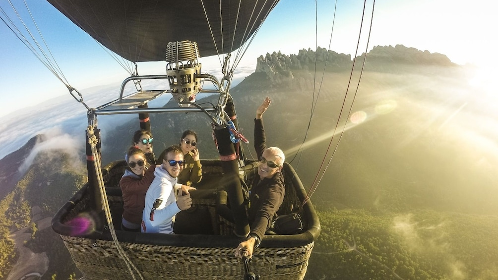 Show item 9 of 9. Group of people in a Hot Air Balloon over Montserrat, Spain