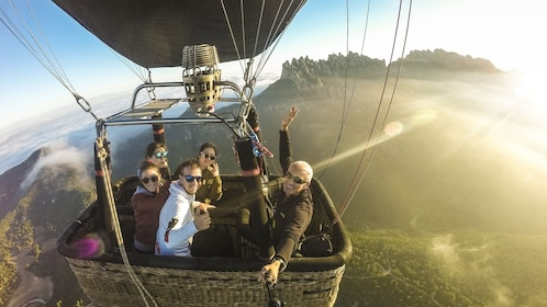Group of people in a Hot Air Balloon over Montserrat, Spain