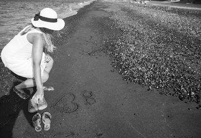 Black and white image of a woman on a beach