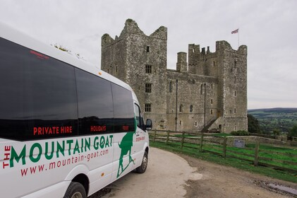 Tour van and castle at Yorkshire Dales National Park in England