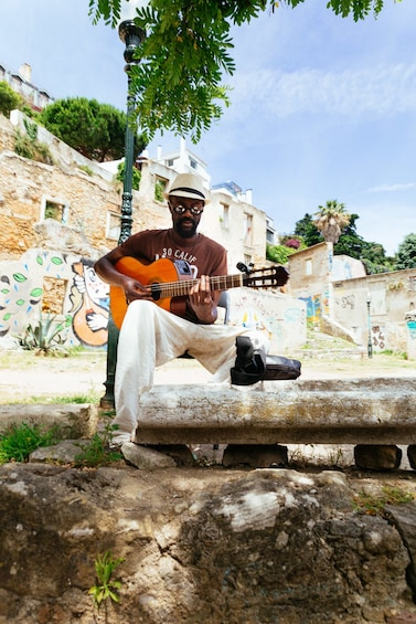 Show item 2 of 10. Man playing guitar in Lisbon, Portugal
