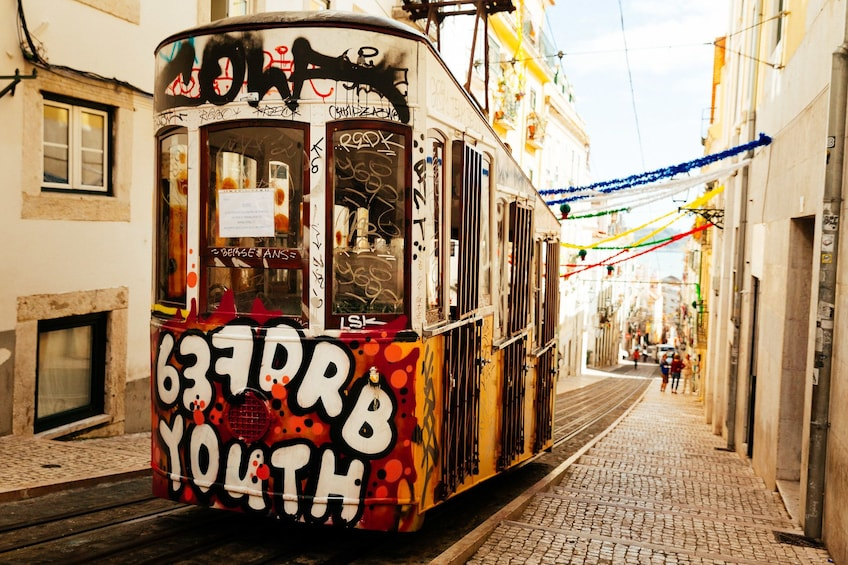 Show item 1 of 10. Graffiti covered trolley in Lisbon