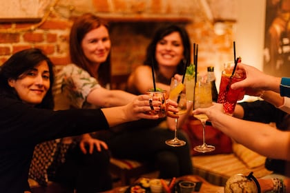 Group toasting cocktails in a bar.