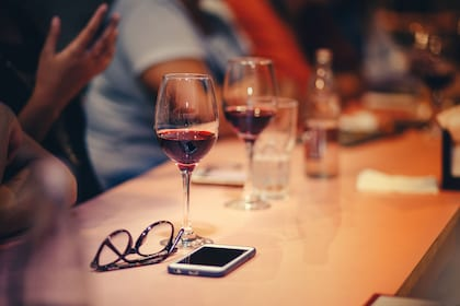 Table with glasses of wine, glasses and a mobile phone in Santa Barbara, California