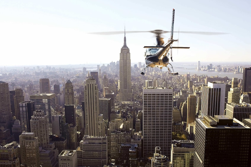 Show item 2 of 4. Helicopter flying around New York City
