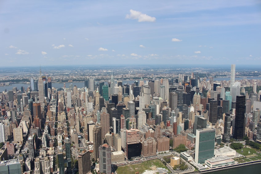 Show item 3 of 4. Aerial view of the NYC skyline during the day