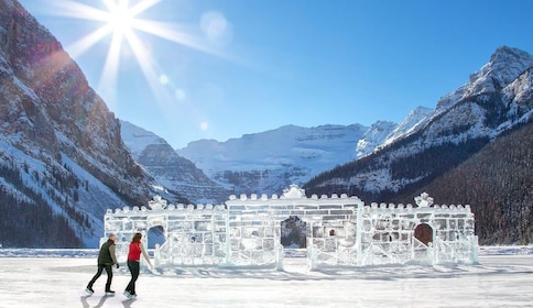 Skating on a frozen lake with ice sculptures in view at Lake Louise during winter time