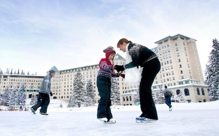 Mother and son ice skating in Banff