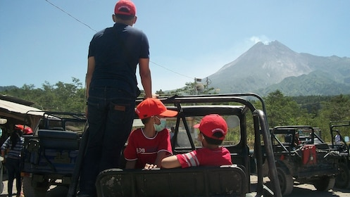 Man and children in a jeep in Indonesia