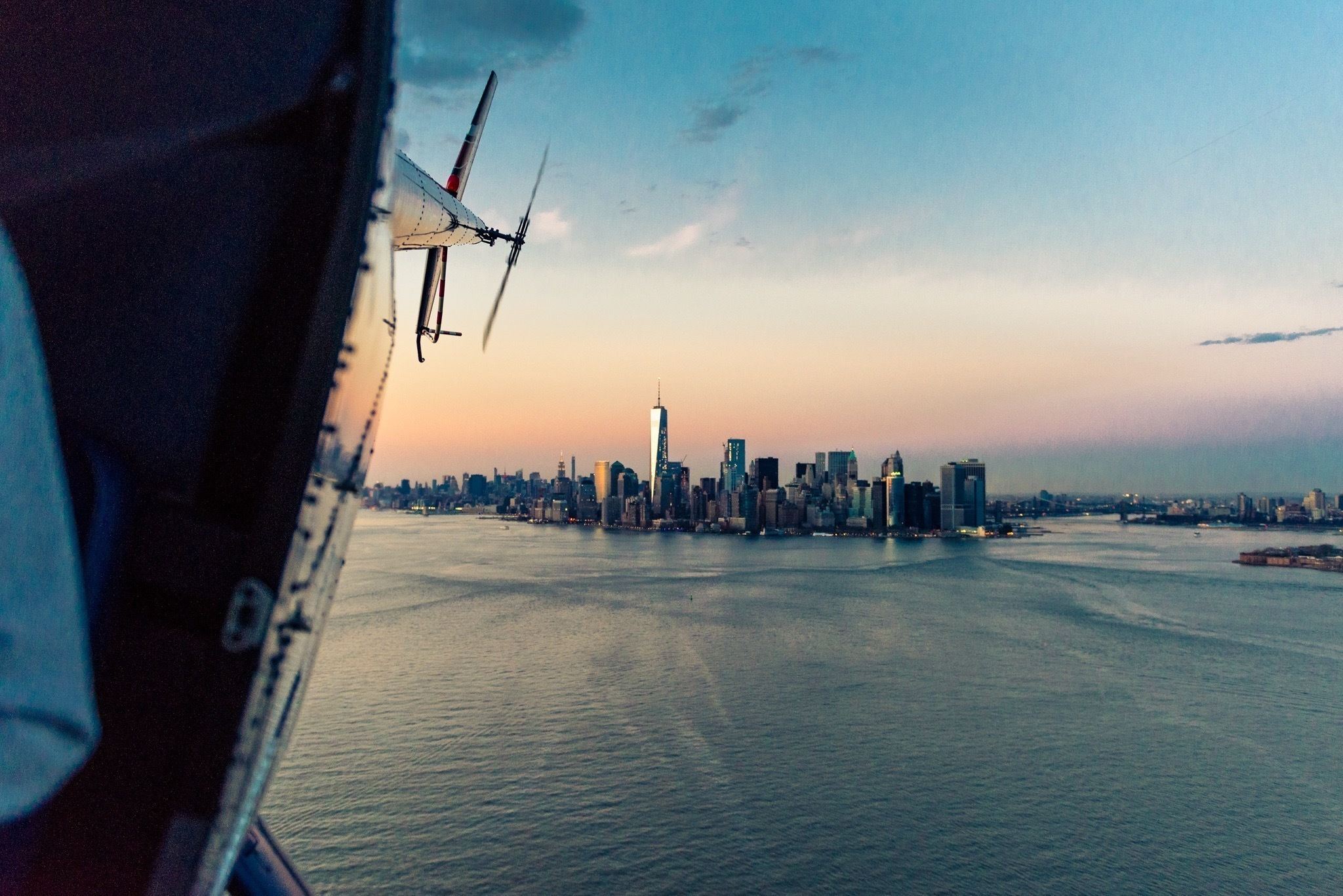 Aerial sunset views of NYC from a helicopter