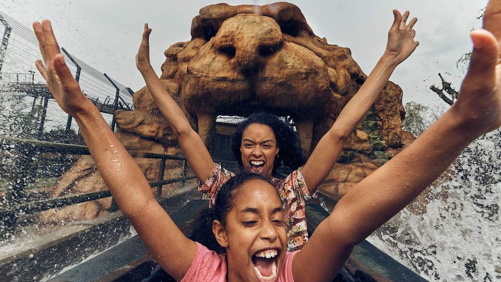 Show item 1 of 10. Ladies getting a splash from a ride at Chessington World of Adventures Resort