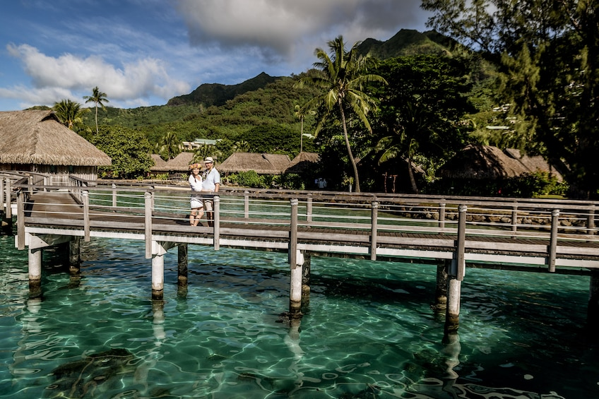 Show item 1 of 5. Couple on a pier in Mo'orea