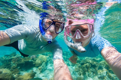 Snorkelers pose for an underwater photo