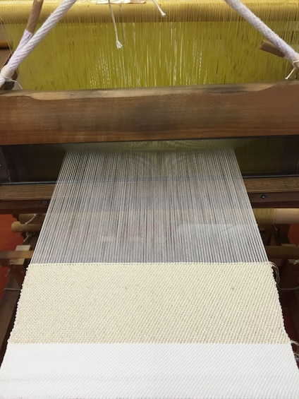 Show item 1 of 6. Loom weaving white silk string in Kyoto, Japan