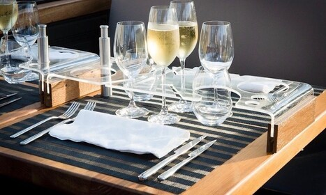 Table setting for a gourmet dinner on board a double-decker bus in London