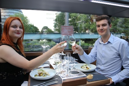 Couple enjoying drinks aboard the BUSTRONOME double decker bus in London