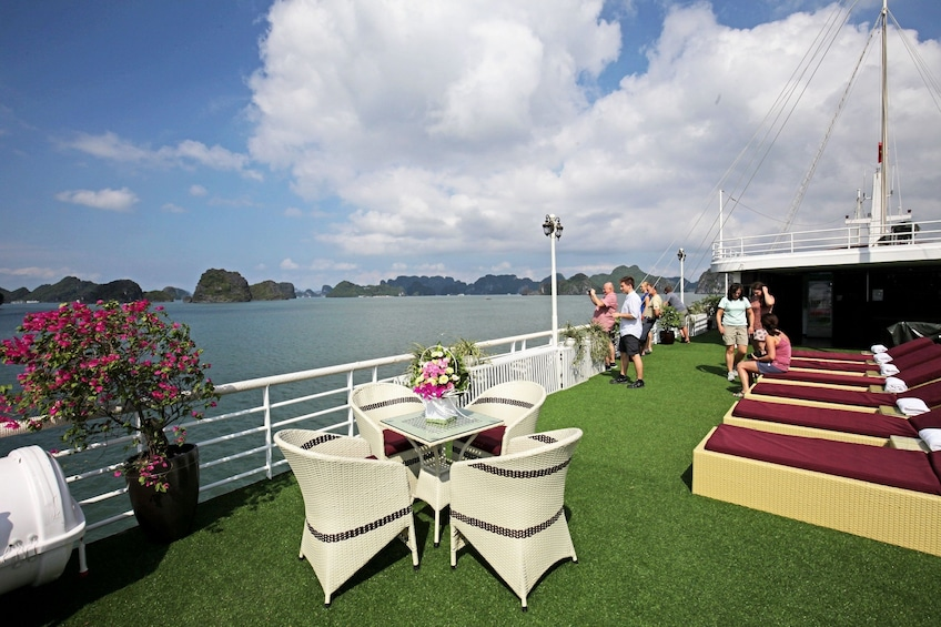 Show item 4 of 10. Grassy lounge area on a cruise ship near Halong Bay