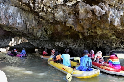Rafting group going through caves on Thalu Island