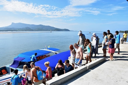 Tour group boarding a boat in Thailand
