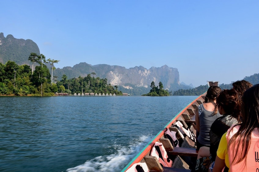 Show item 1 of 10. Boating tour on Cheow Lan Lake in Thailand