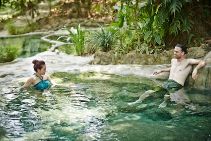 A couple relaxing at the Waree Raksa Hot Spring Spa in Krabi Rainforest