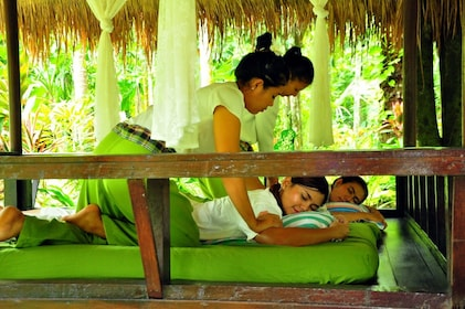 Guests receive relaxing massages at the Waree Raksa Hot Spring Spa in Krabi Rainforest