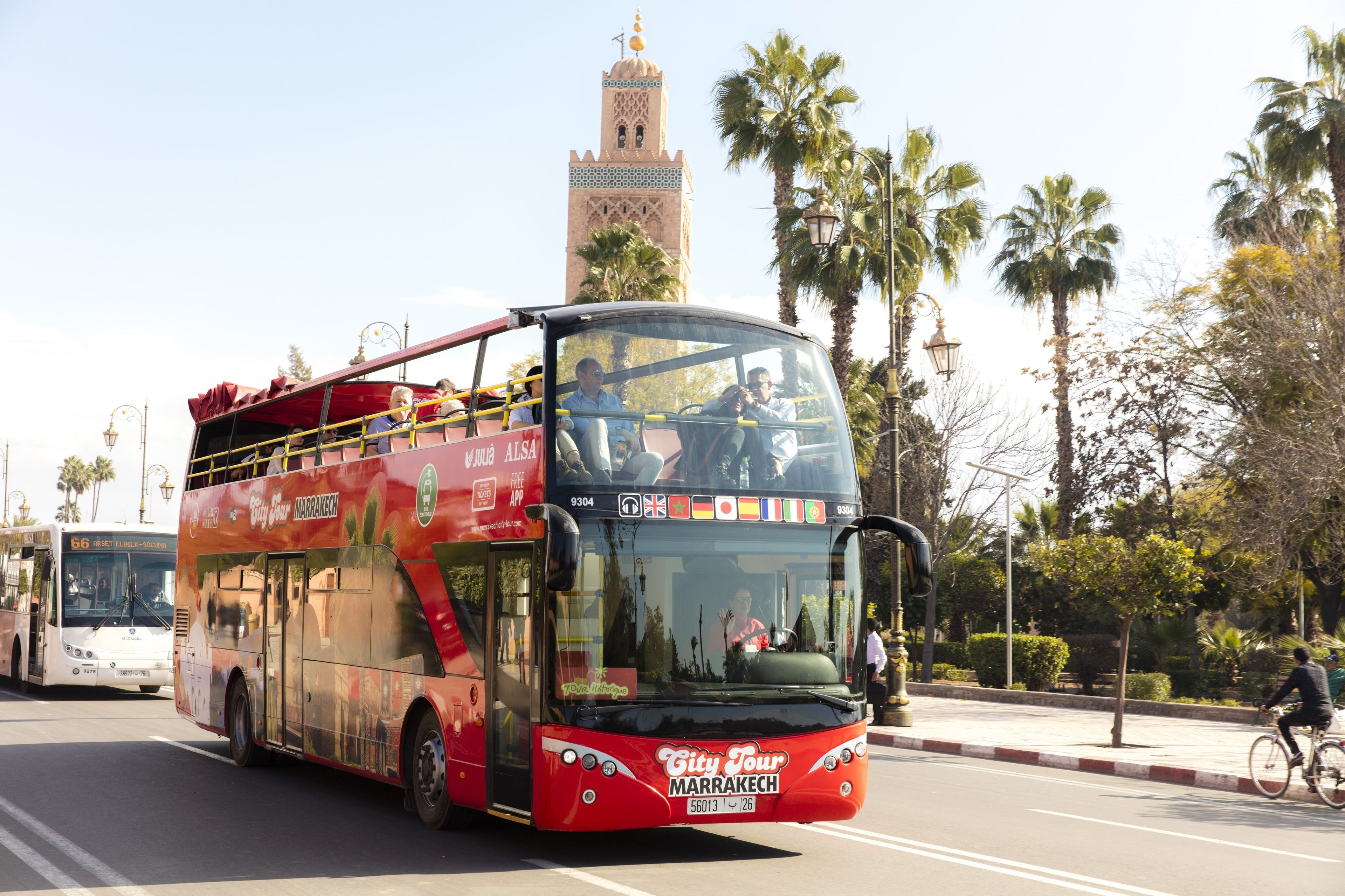 Bus driving on the street on the Hop On-Hop Off Marrakech City Tour