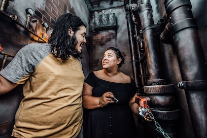 Couple solving puzzles in a room escape game in Houston