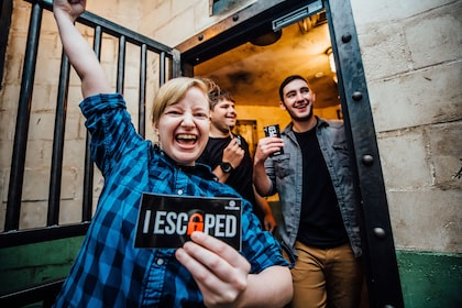 Triumphant group emerging from room escape game in Houston