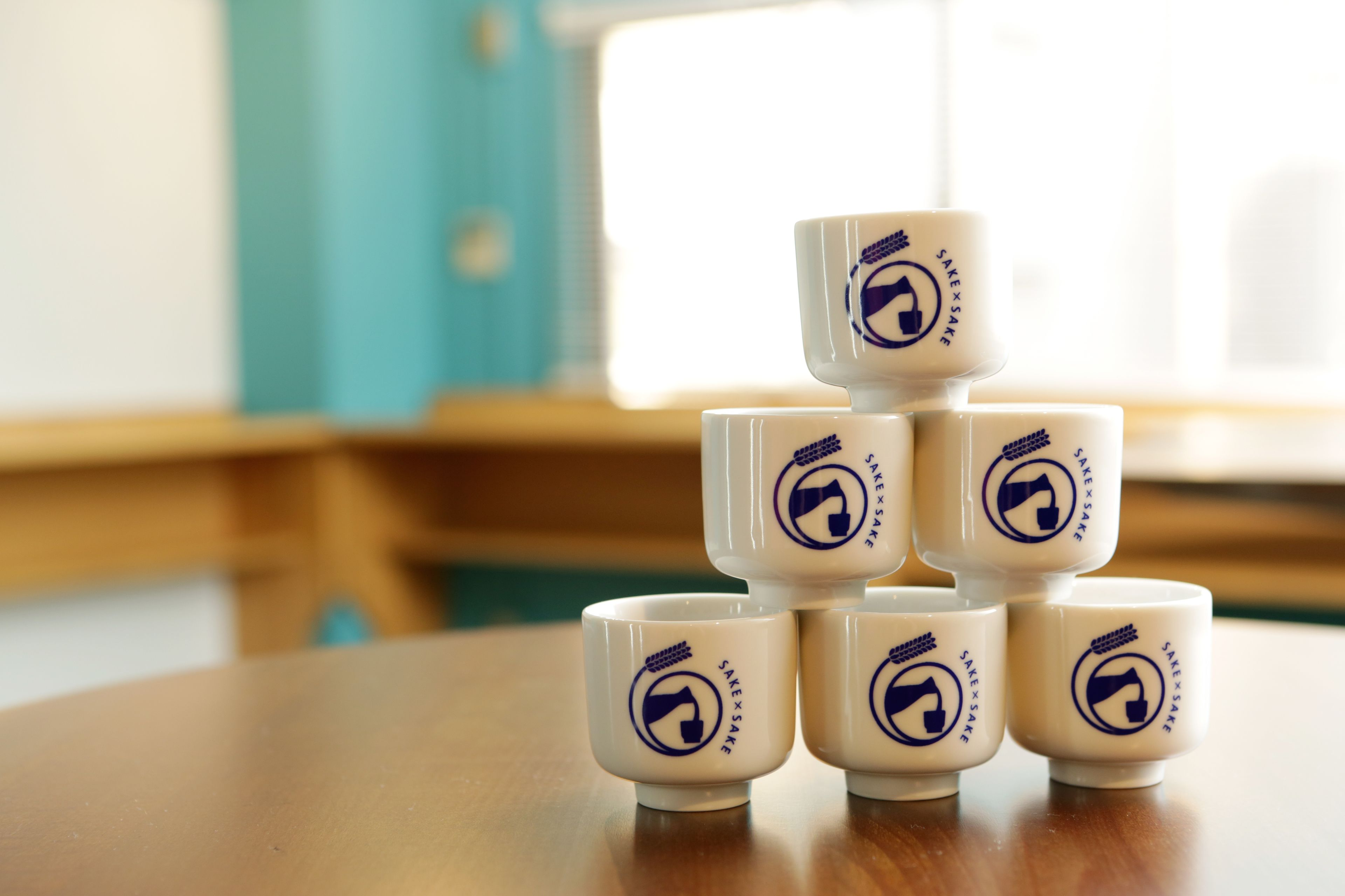 Six sake cups stacked in a pyramid