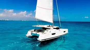 Luxury Catamaran Trip to Isla Mujeres & Private Beach Club