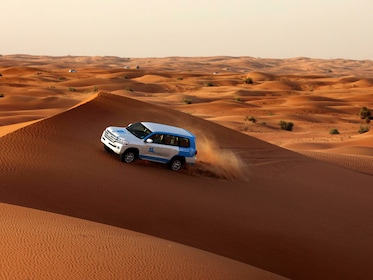 View of SUV driving into the Lahbab Desert