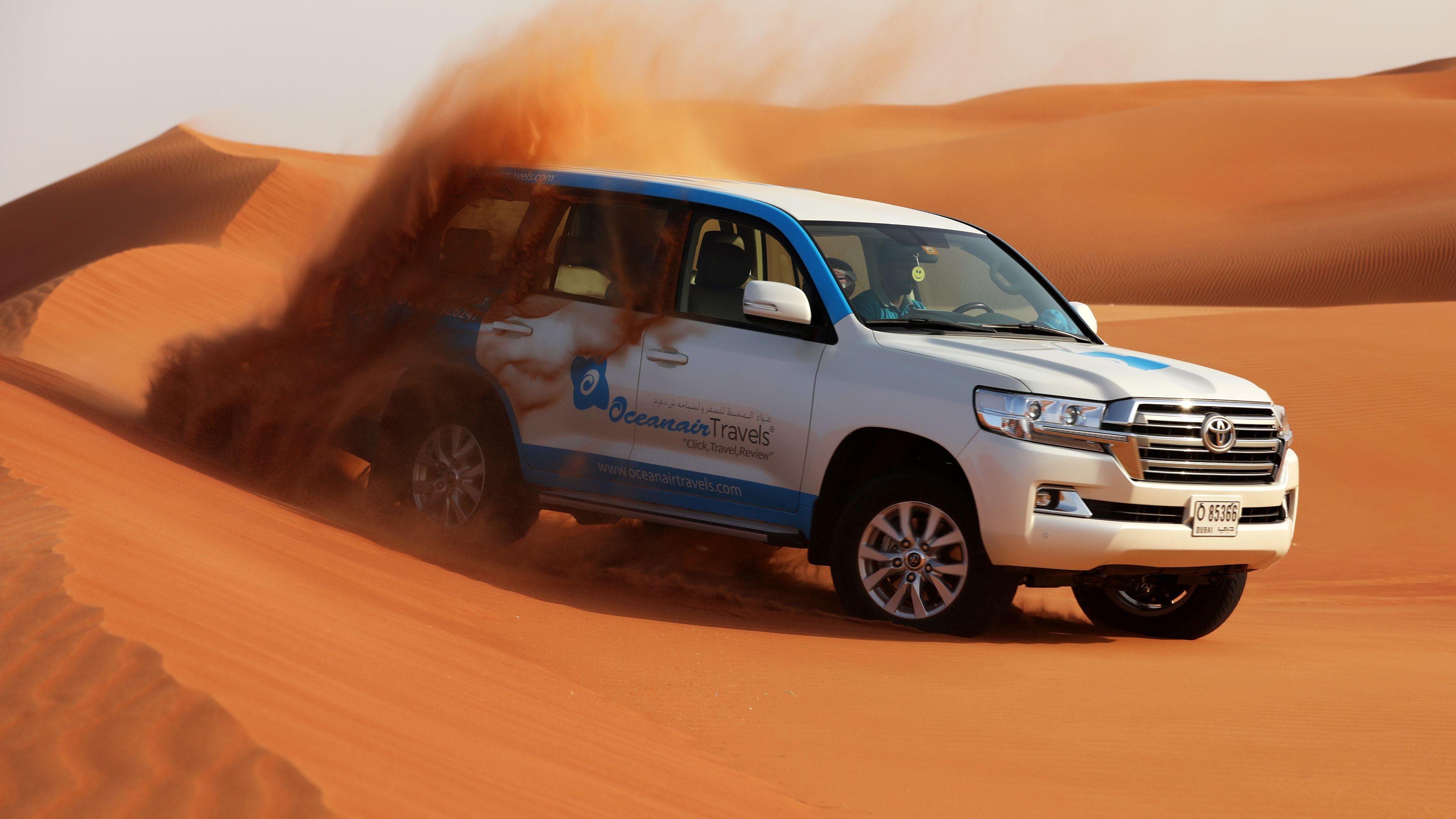 Dubai Morning Safari: Red Dunes, Sandsurf, Camels & Brunch