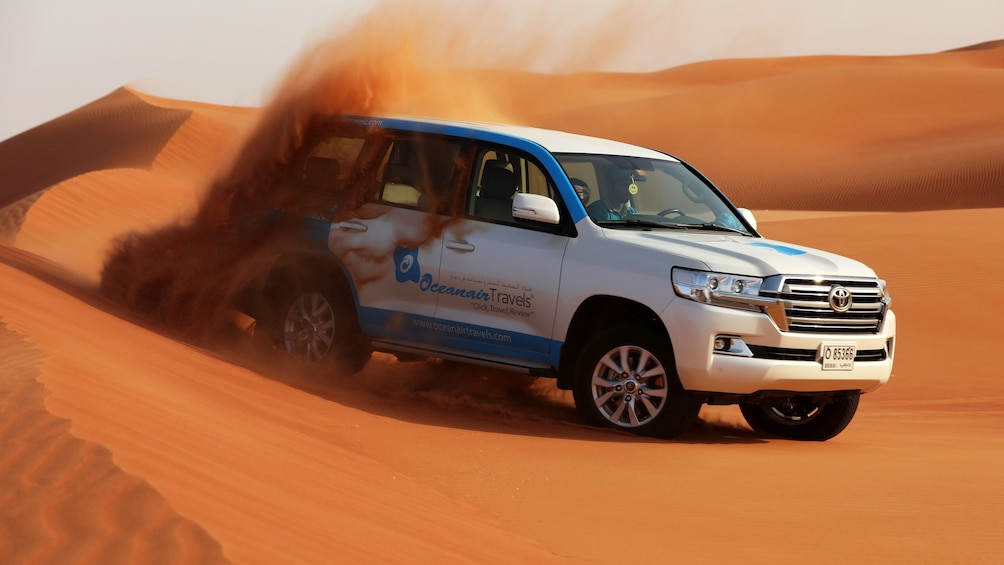 Show item 1 of 10. Dubai Morning Safari: Red Dunes, Sandsurf, Camels & Brunch