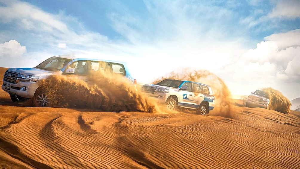 Show item 10 of 10. Dubai Morning Safari: Red Dunes, Sandsurf, Camels & Brunch