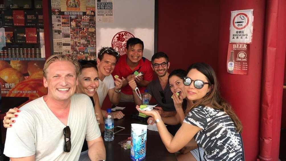 Show item 3 of 4. Group eating on a food tour in Singapore