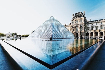 Glass pyramid, reflecting pool and Louvre Museum in Paris