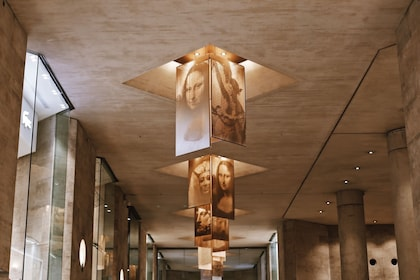 Artistic decor on the ceiling of the Louvre Museum in Paris