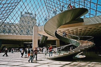 Spiral staircase under the glass pyramid at the Louvre Museum in Paris