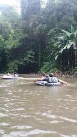 People on inner tubes on a river in Costa Rica