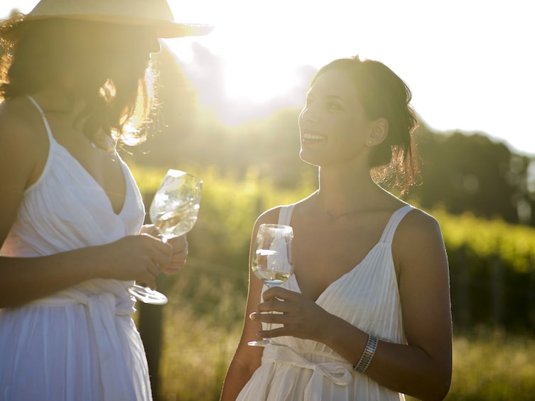 Show item 1 of 8. Women drinking wine at a vineyard in Hunter Valley