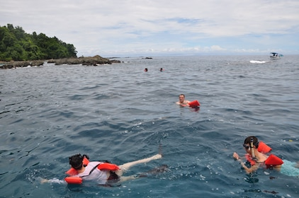 Group swimming with life preservers off the coast of Caño Island