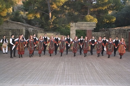 Row of Greek dancers putting on a show in Athens