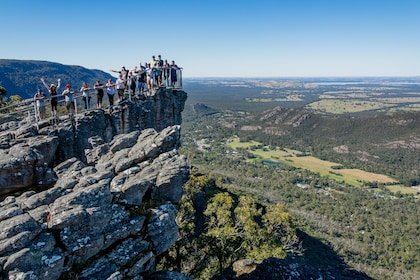 Group at a scenic viewpoint on a mountain in Australia