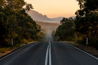 Road with mountains in the distance in Australia