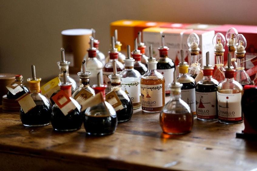 Show item 8 of 8. Bottles of vinegar on a tour in Bologna