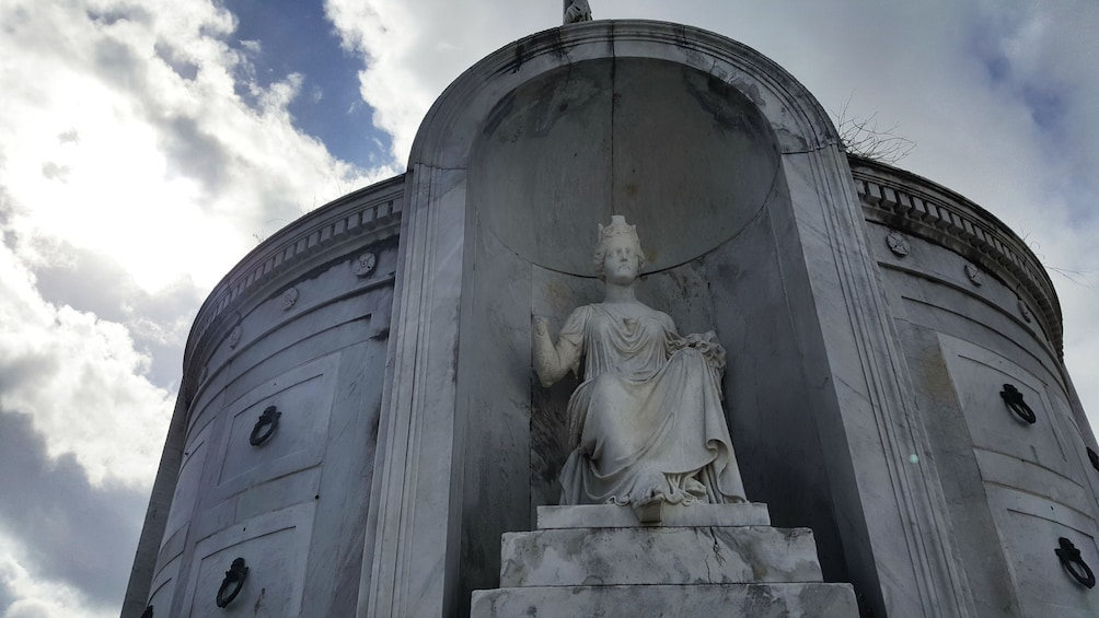 Show item 2 of 5. Sculpture in a cemetery in New Orleans